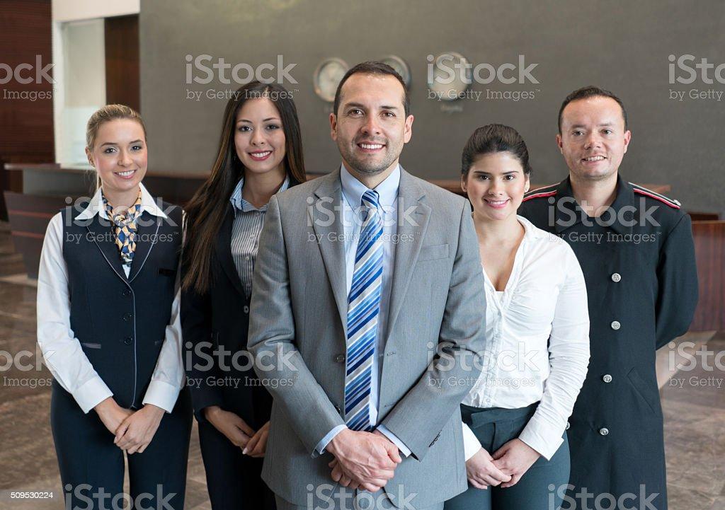 Friendly hotel staff smiling stock photo