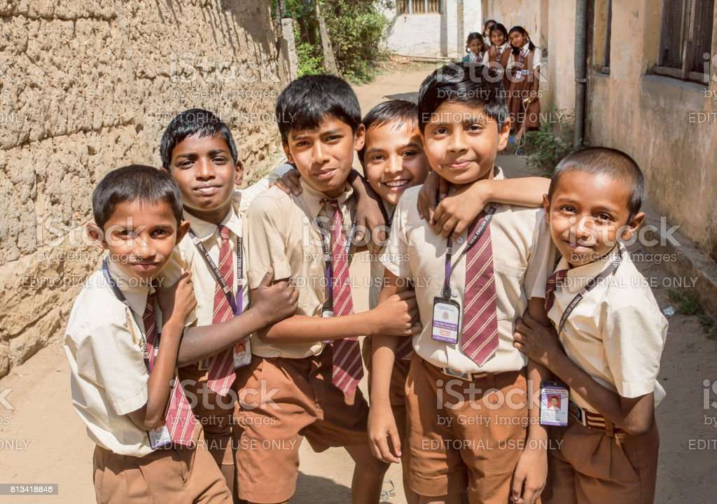 Unidentified friendly kids in school uniform having games with smily...