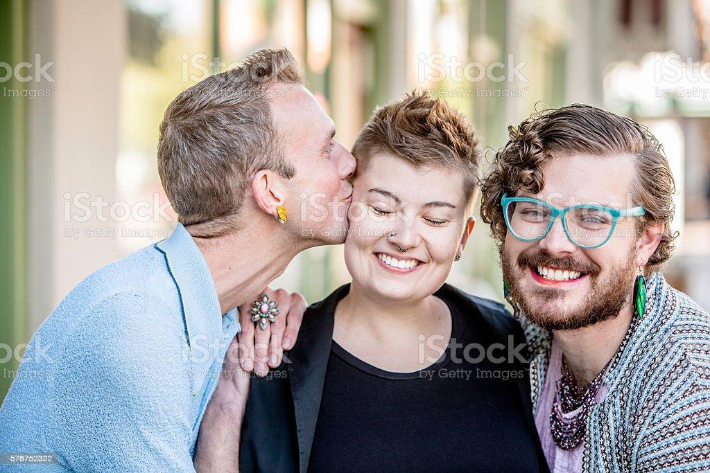 Friendly Kiss Among Friends stock photo