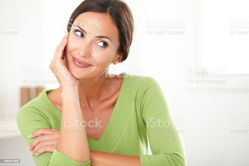 Friendly latin lady smiling and looking satisfied stock photo