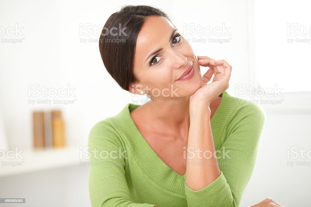 Friendly latin lady smiling at home stock photo