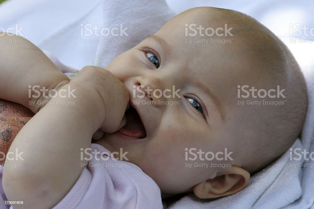 Friendly laughing baby royalty-free stock photo