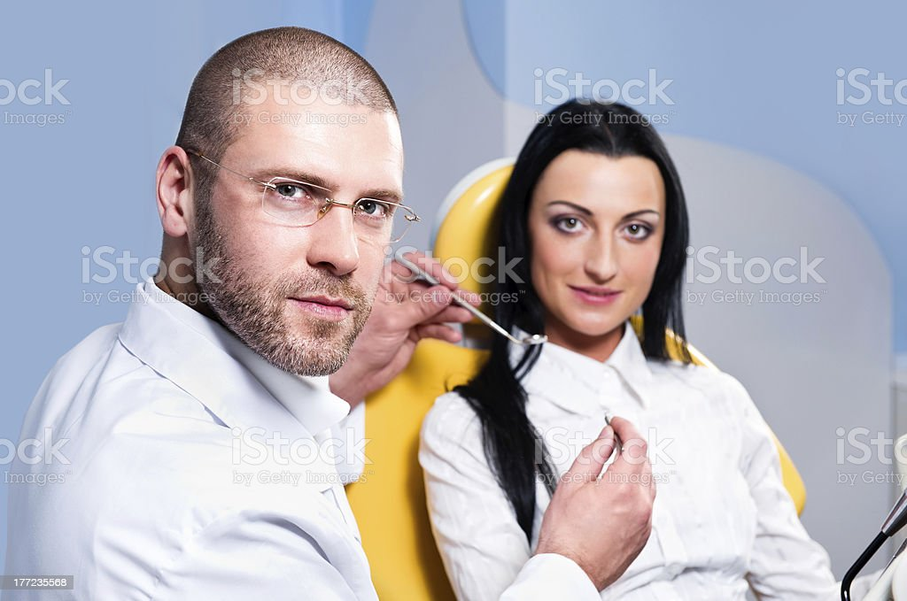 Friendly male dentist with patient royalty-free stock photo