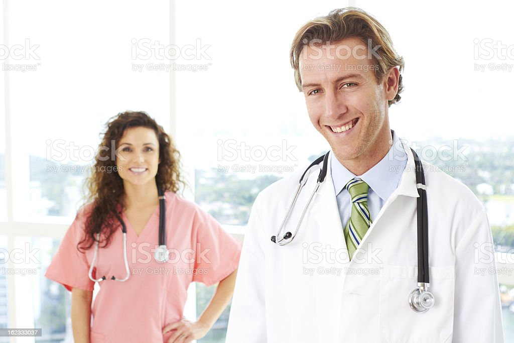 Friendly male doctor and nurse stock photo