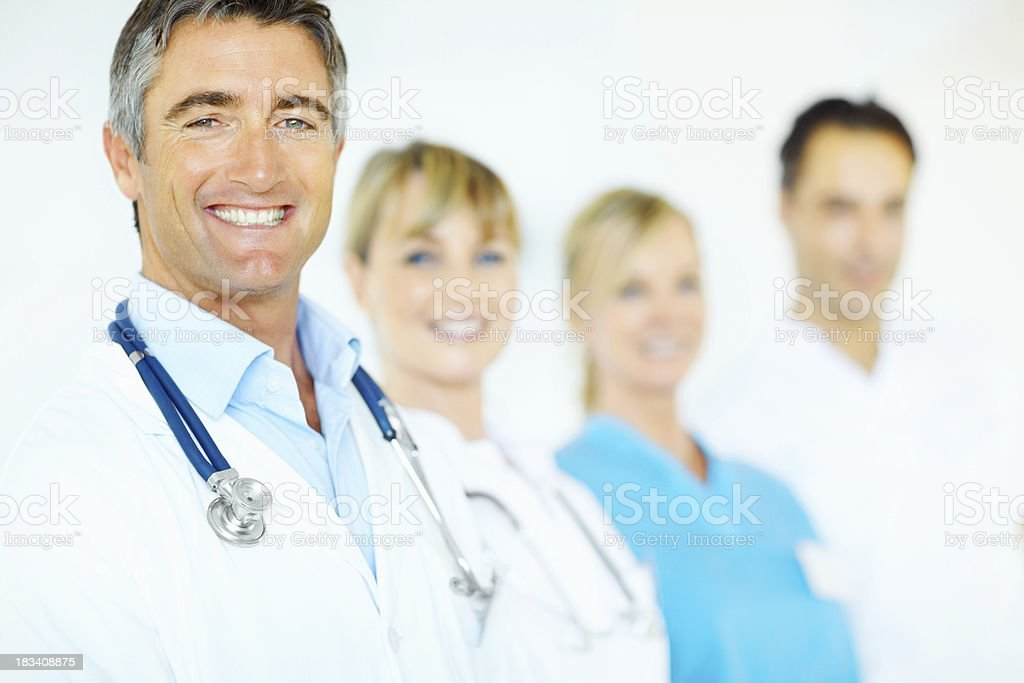 Friendly male doctor leading his team royalty-free stock photo