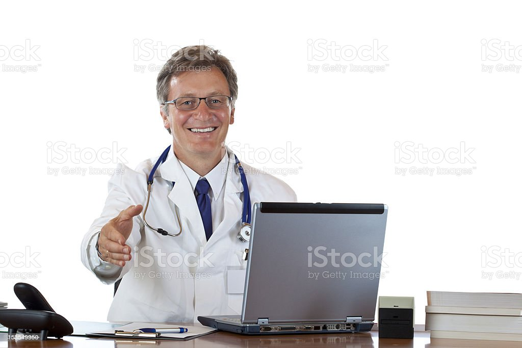 Friendly male doctor sitting in office offering hand for handshake royalty-free stock photo