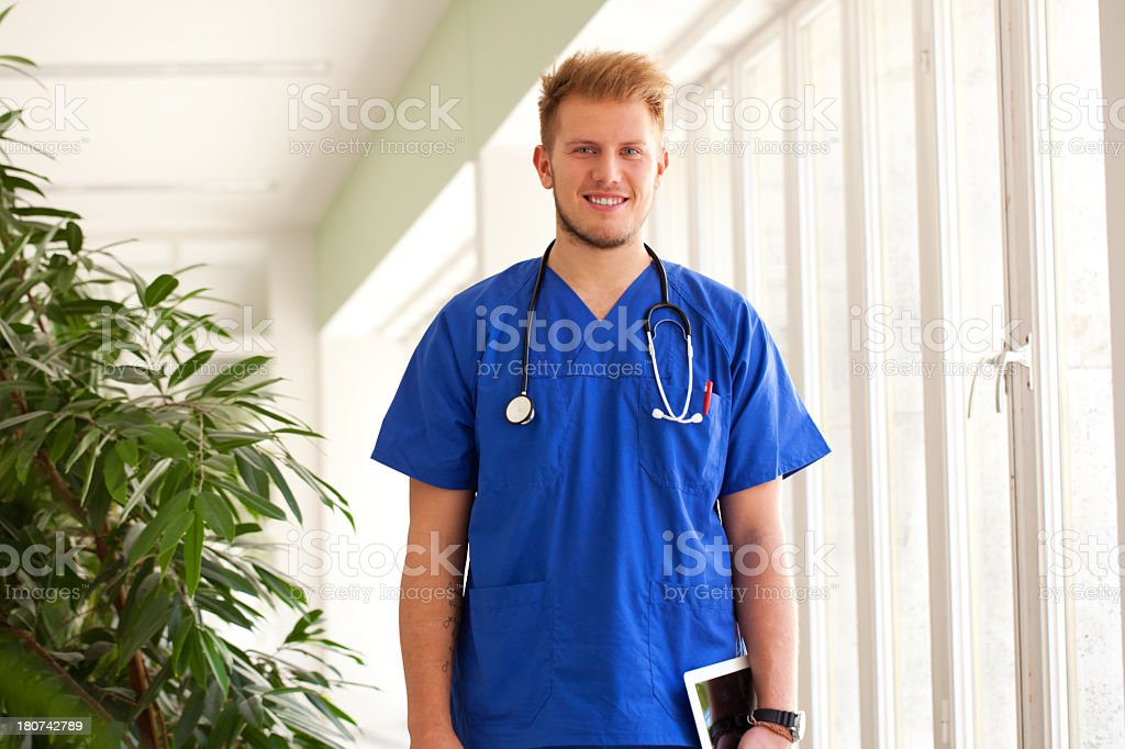 Friendly male nurse at the hospital stock photo