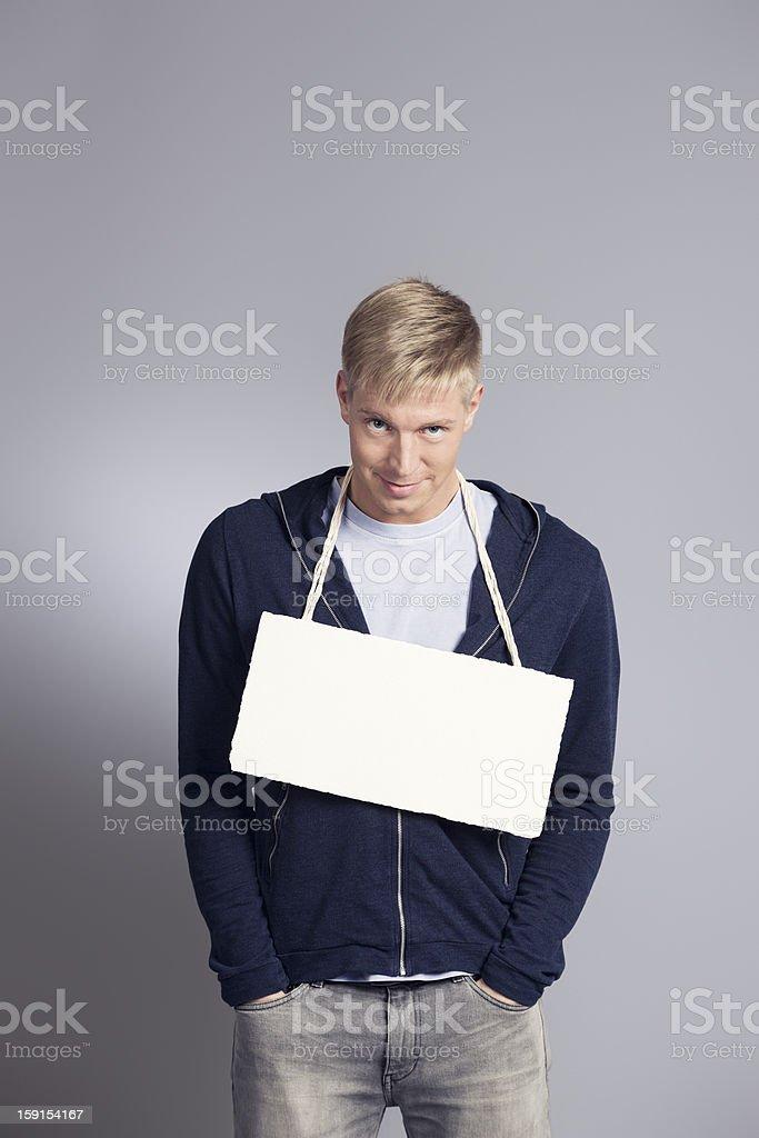 Friendly man presenting blank signboard. royalty-free stock photo