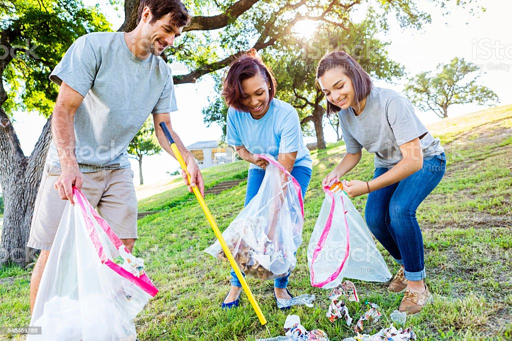 Friendly neighbors help with park clean up stock photo