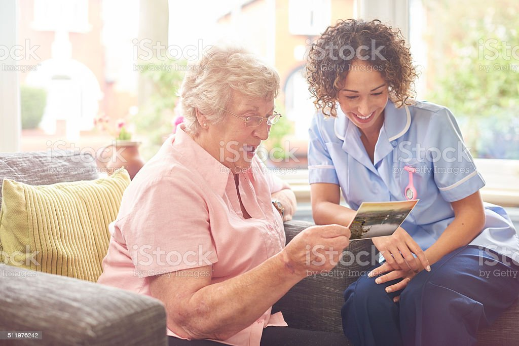 friendly nurse house call stock photo