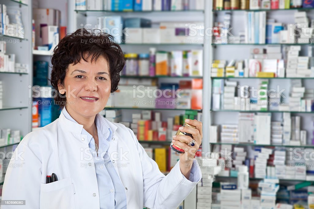 Friendly Pharmacist with Pills royalty-free stock photo