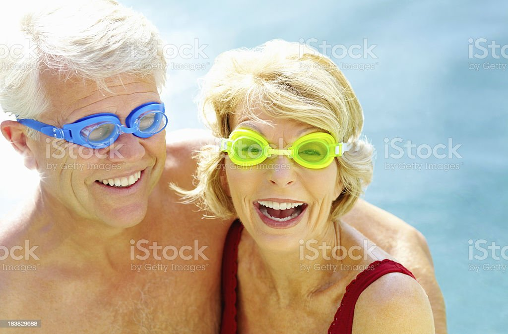 Friendly retired couple wearing swimming goggles royalty-free stock photo