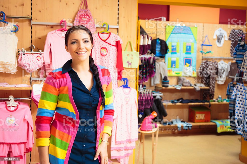 friendly sales person at children's store stock photo