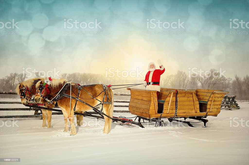 Friendly Santa Waving to Viewer With Sleigh and Horse Team stock photo