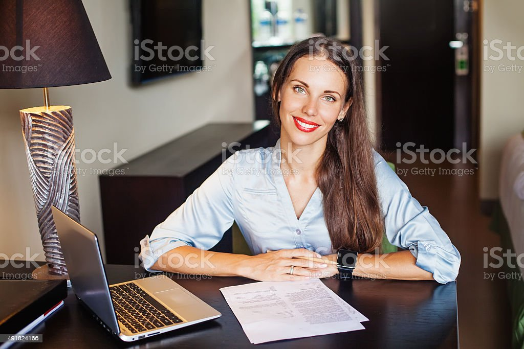 friendly self-employed female lawyer sitting in her office stock photo