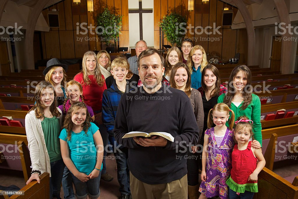 Friendly Smiling Church Indoors Group Pastor stock photo