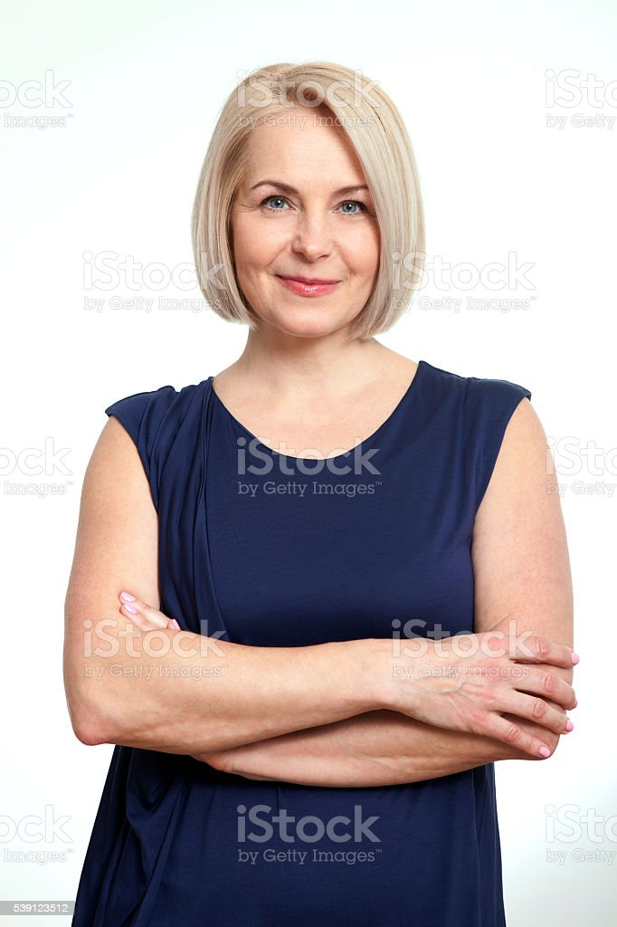 Friendly smiling middle-aged business woman isolated on white ba stock photo