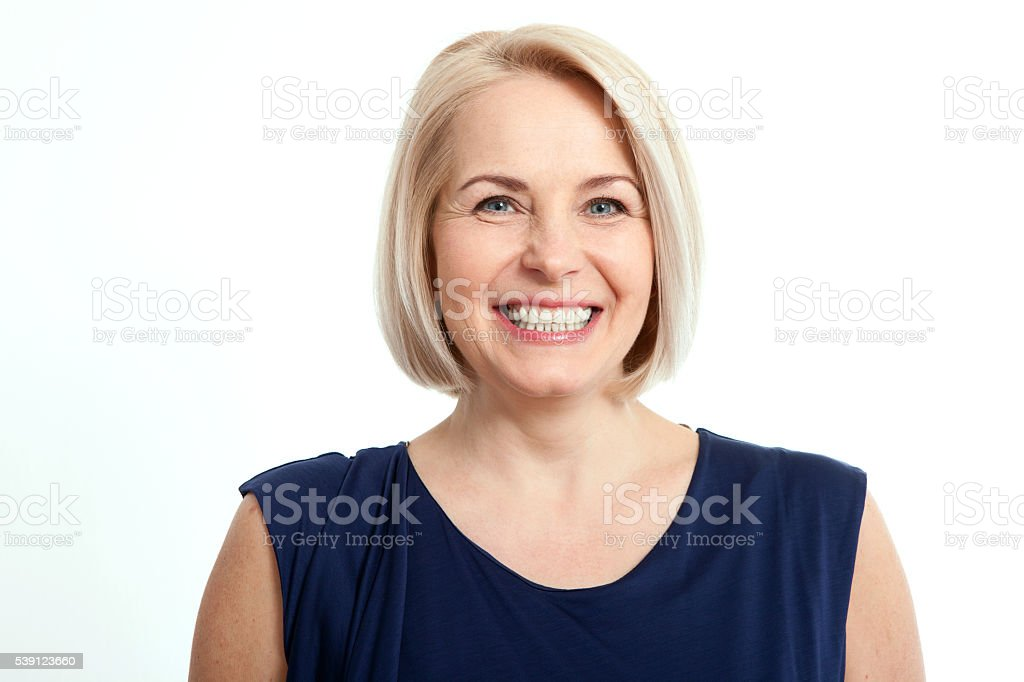 Friendly smiling middle-aged business woman isolated on white background stock photo