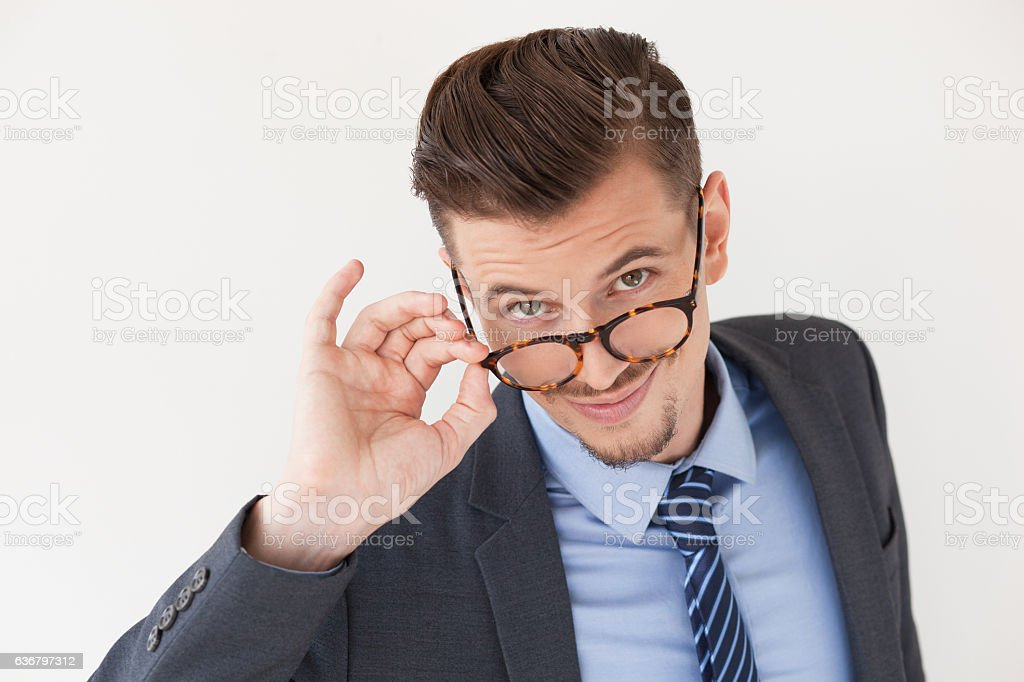 Friendly Stylish Business Man Removing Glasses stock photo