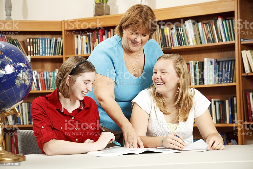 Friendly Teacher Helping Students royalty-free stock photo