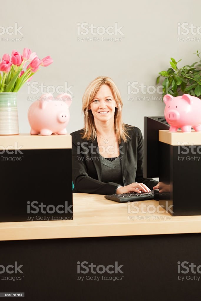 Friendly Woman Banker Working in Retail Banking Teller Window Vt stock photo