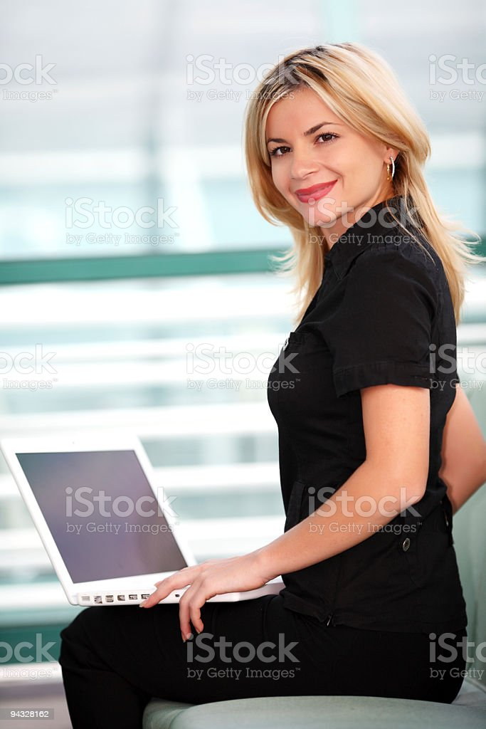 Friendly woman with laptop. royalty-free stock photo