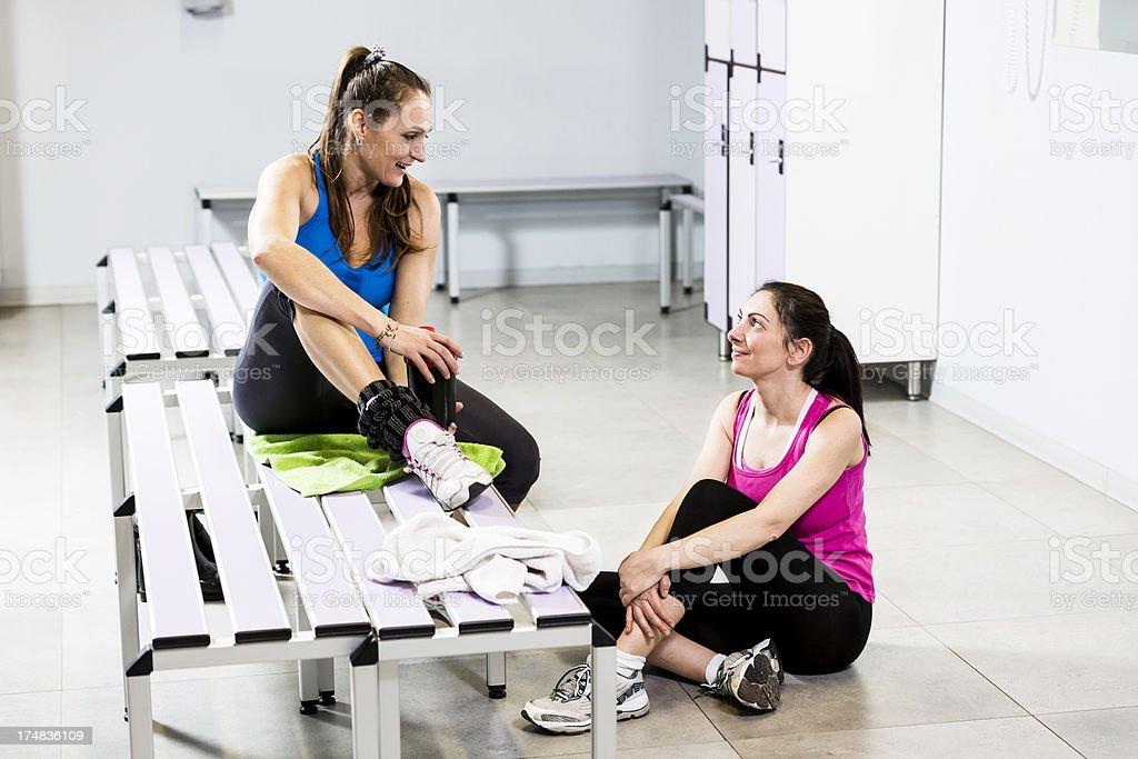 Friendly women talking in a Locker Room royalty-free stock photo