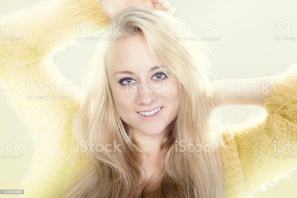 Friendly Women with yellow sweater stock photo