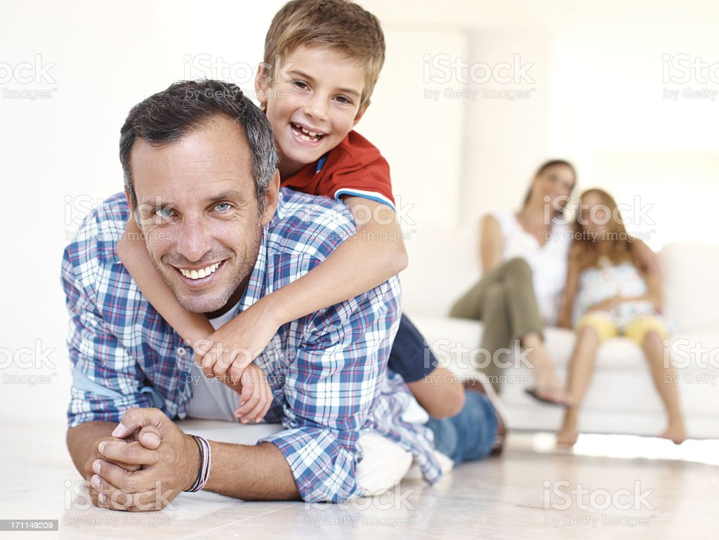 Friendly wrestling match in the family lounge! royalty-free stock photo