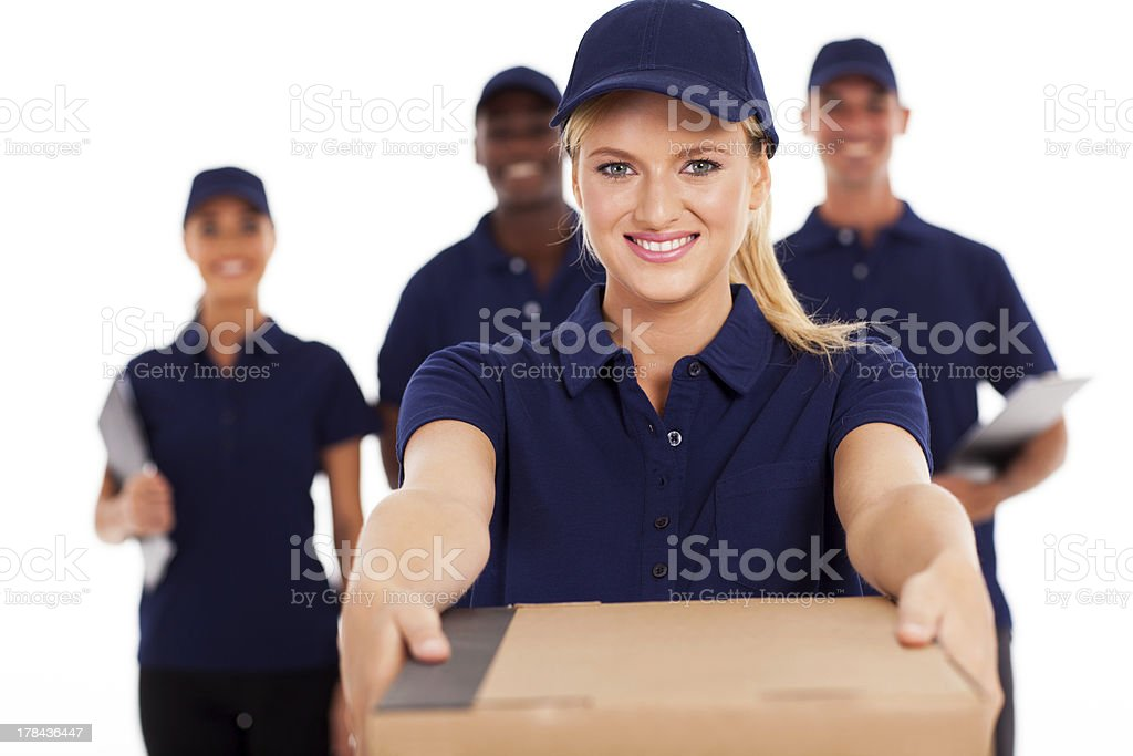 friendly young delivery woman presenting parcel stock photo