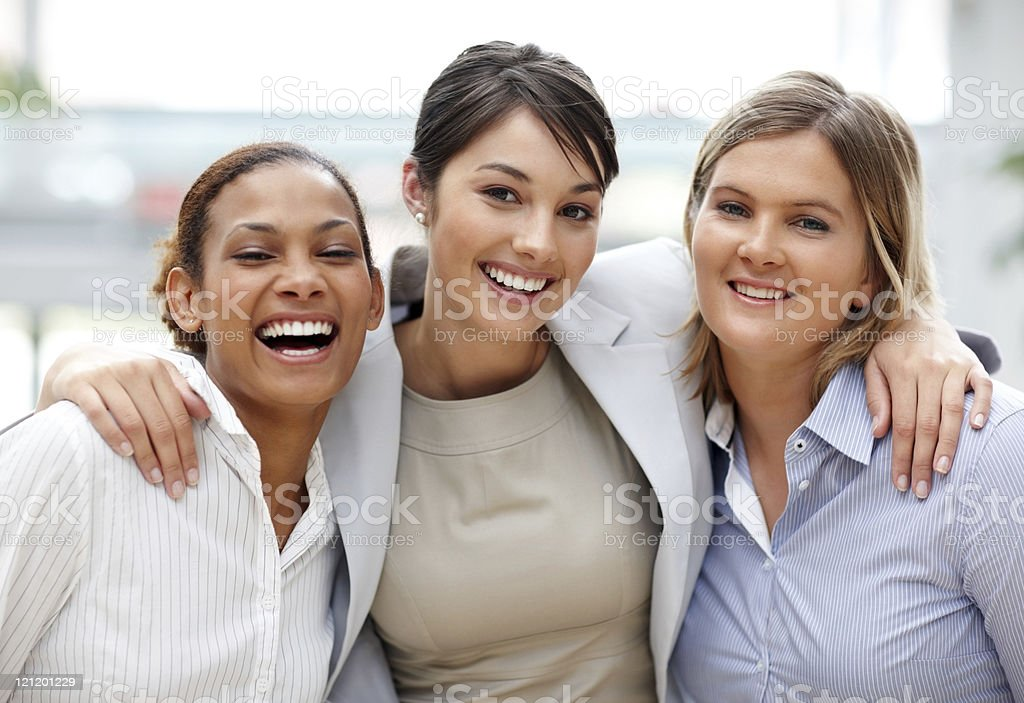 Friendly young executive standing with her coworker royalty-free stock photo