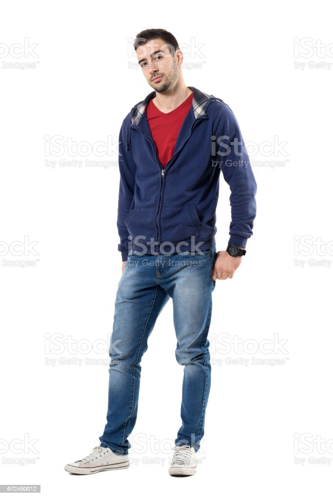 Friendly young handsome guy in blue sweatshirt looking at camera stock photo