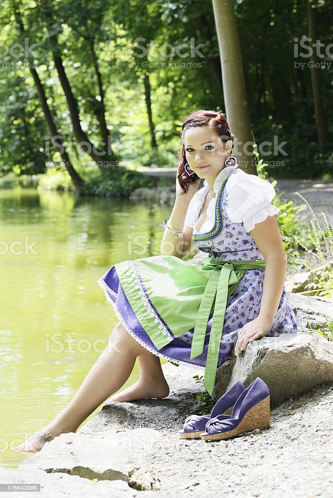 Friendly Young Woman Violet Dirndl Dress Relaxing Summer royalty-free stock photo