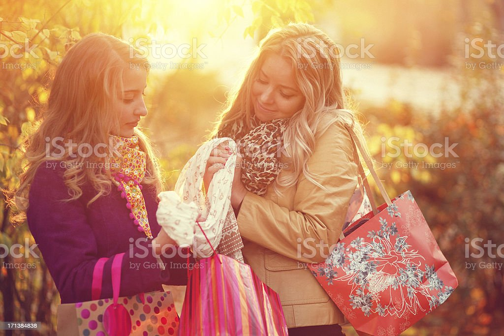 friends after shopping in the autumn park royalty-free stock photo