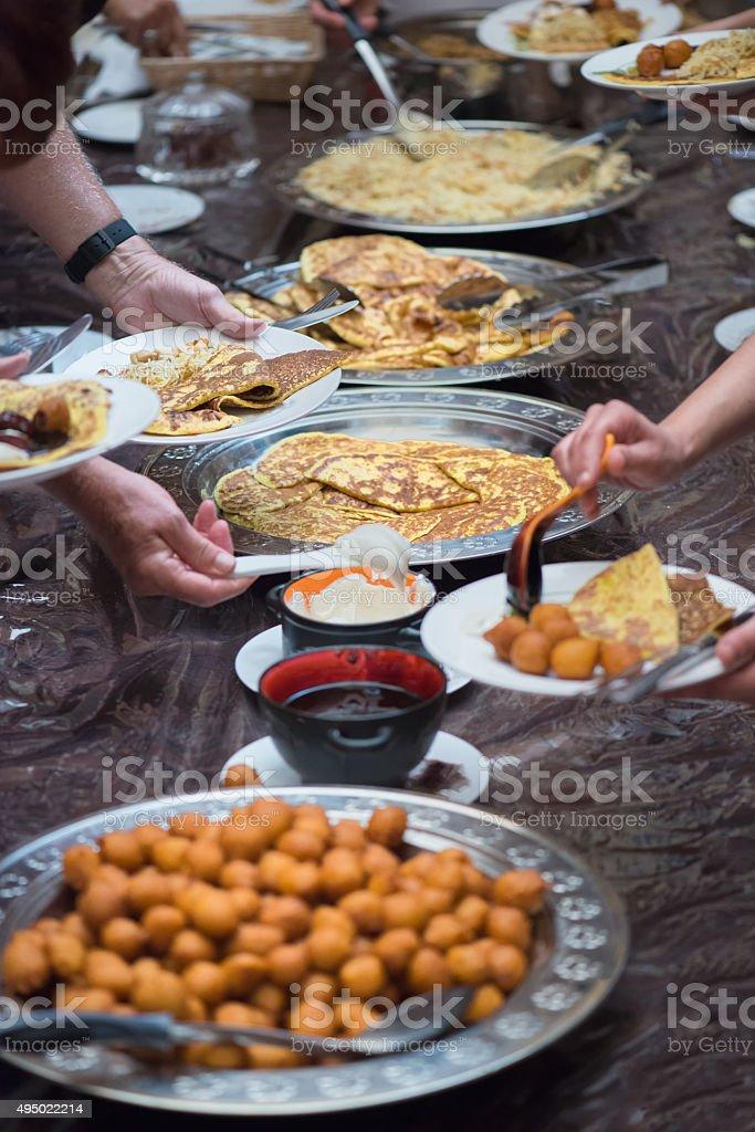 Friends and Family Eating Traditional Emirati Breakfast, Dubai, UAE stock photo