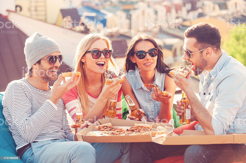 Friends and pizza. stock photo