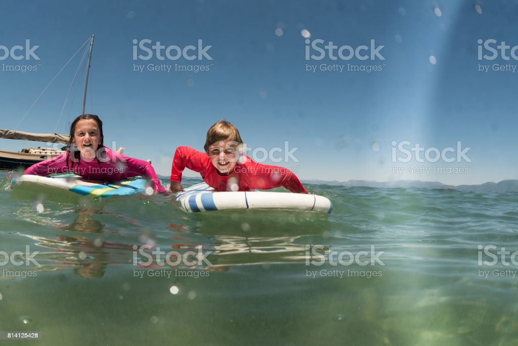 friends and surfing stock photo