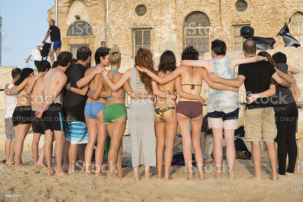 Friends arm-in-arm at the beach in Tel Aviv, Israel royalty-free stock photo