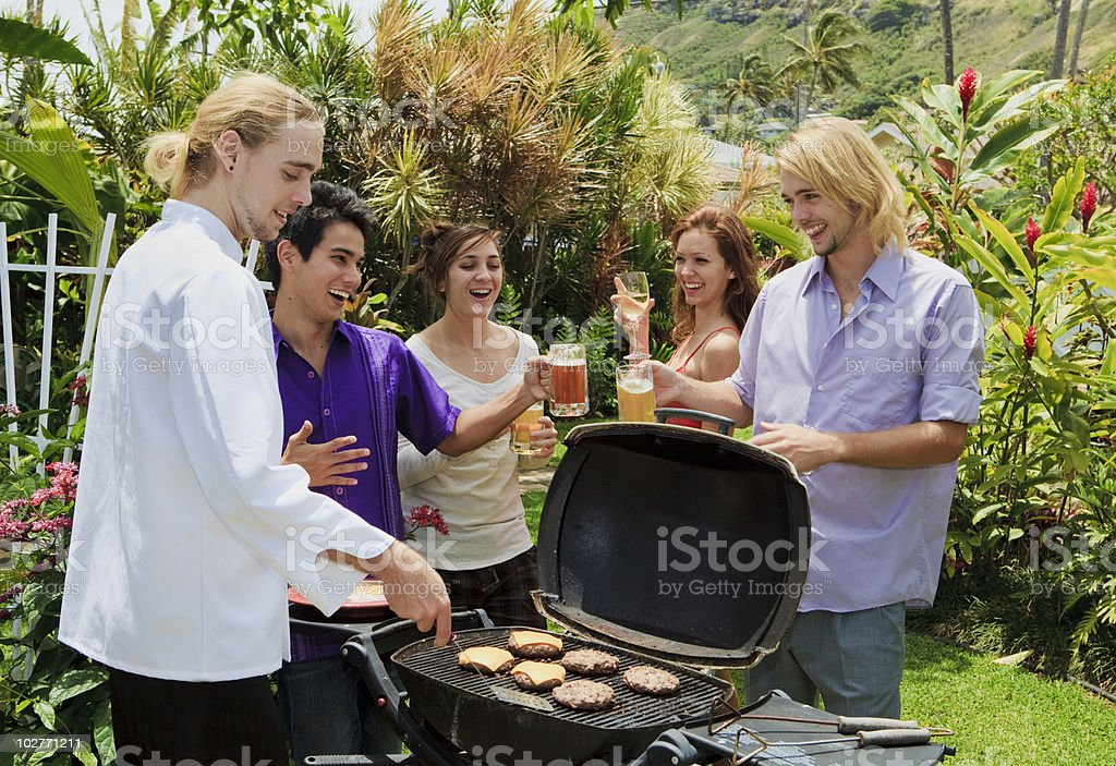friends at a backyard barbeque stock photo
