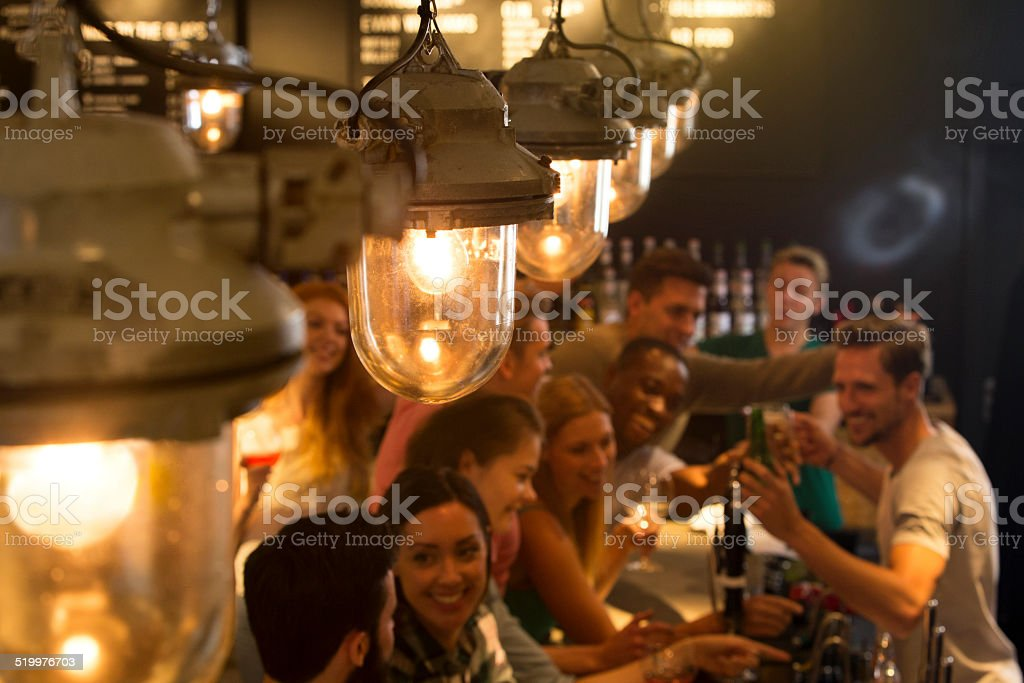 Friends at a Busy Bar stock photo