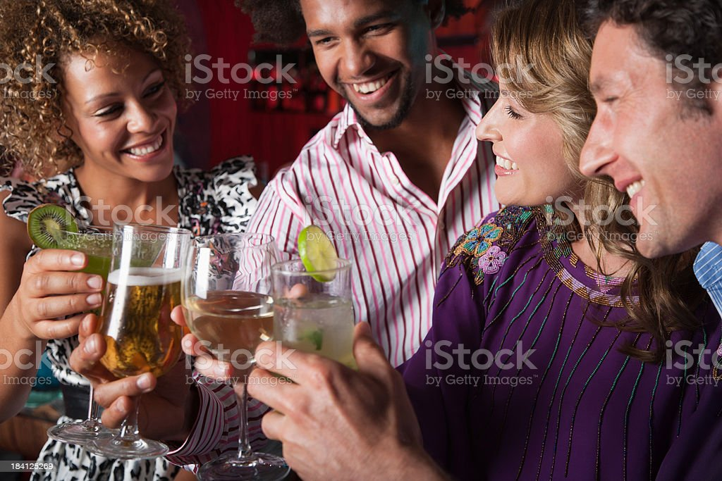 Friends at a club saluting drinks royalty-free stock photo