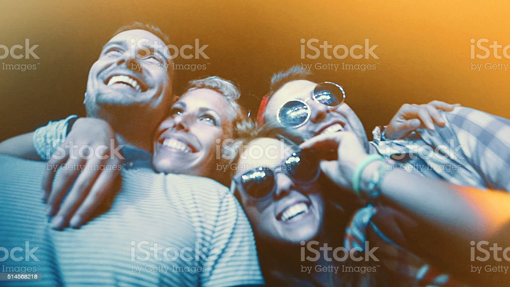 Friends at a concert. stock photo