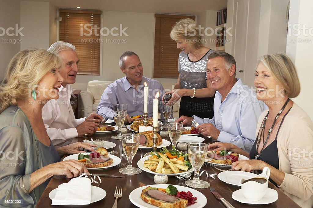 Friends At A Dinner Party stock photo