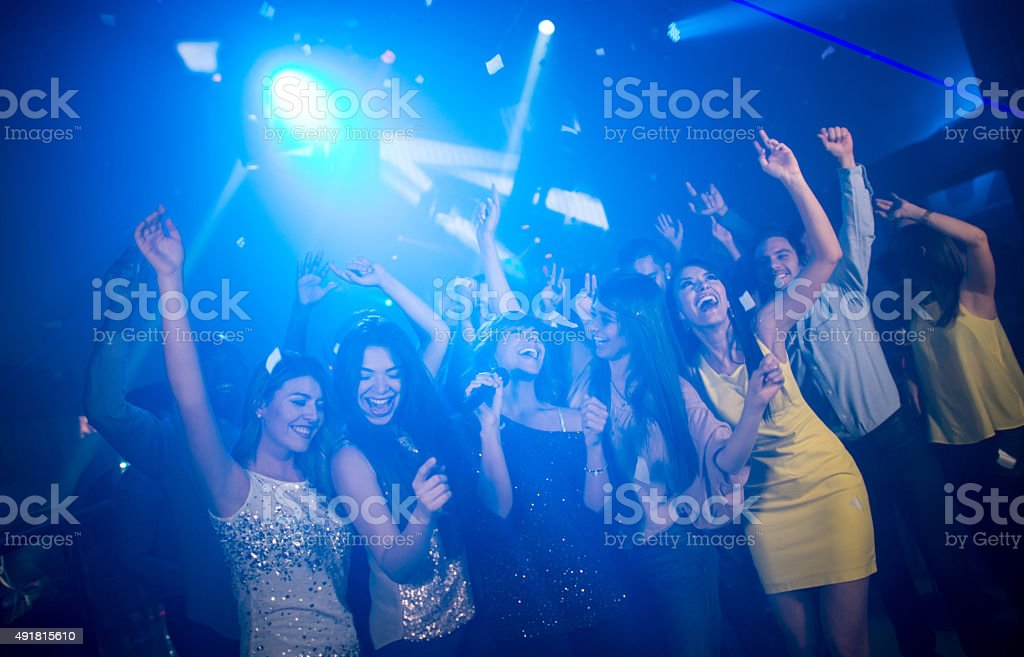 Friends at a karaoke party stock photo