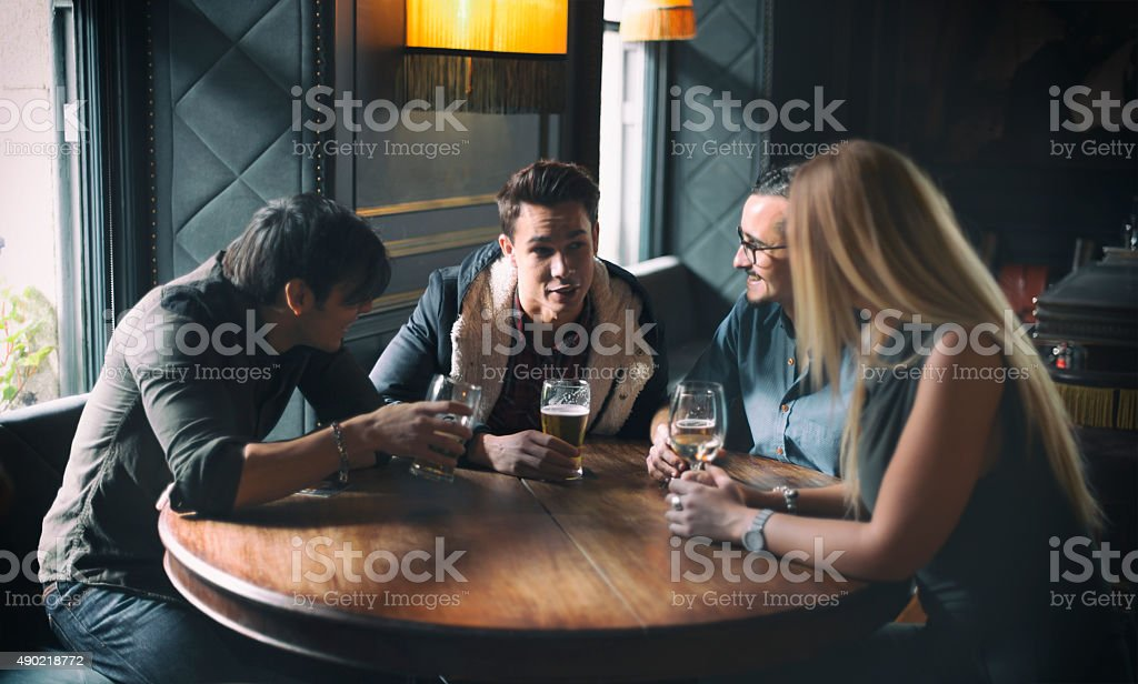 Friends at a pub in Dublin Ireland stock photo