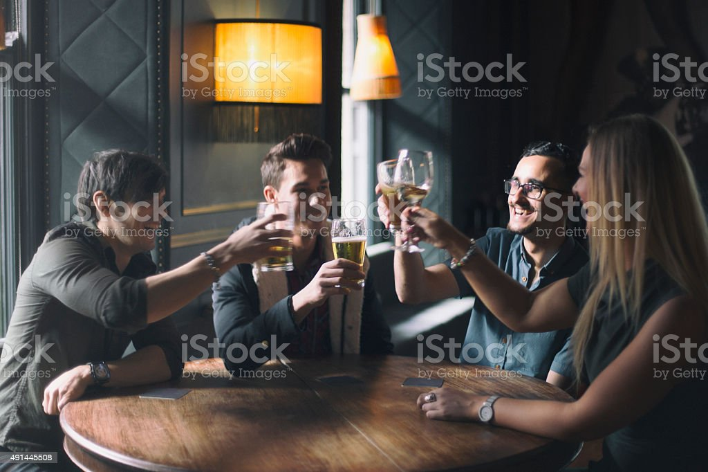 Friends at a pub in Dublin Ireland stock photo