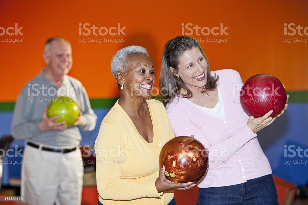 Friends at bowling alley stock photo