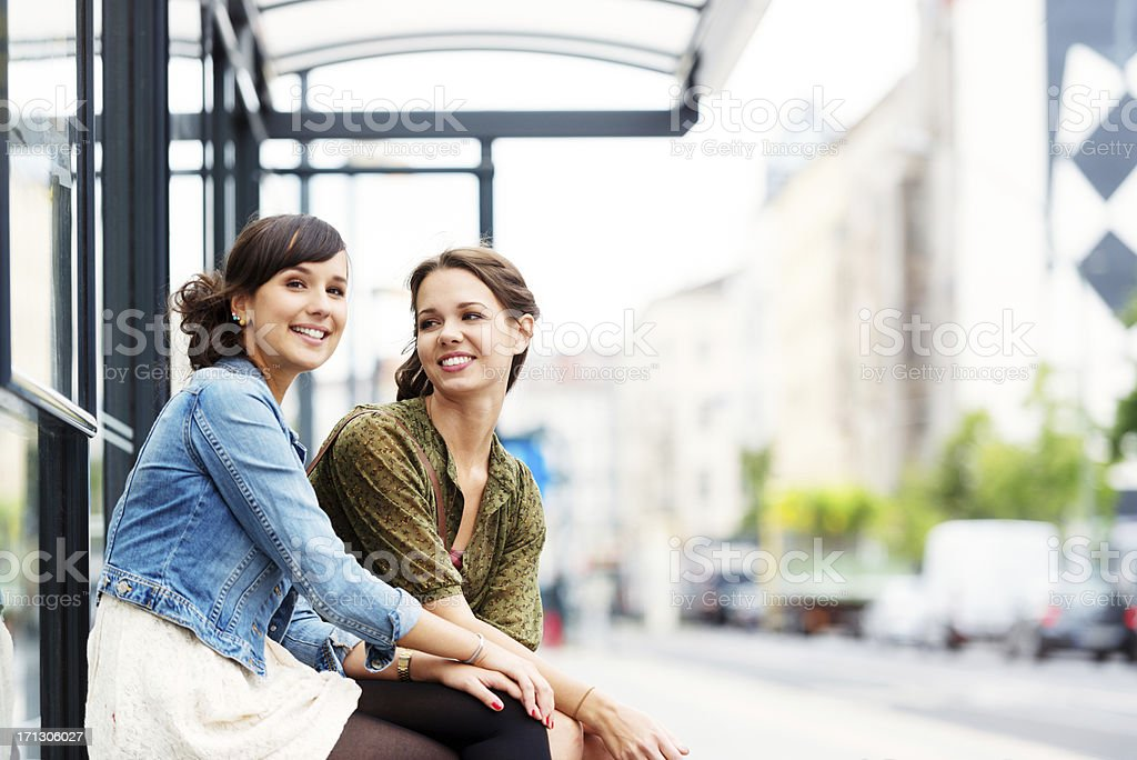 Friends at bus stop stock photo