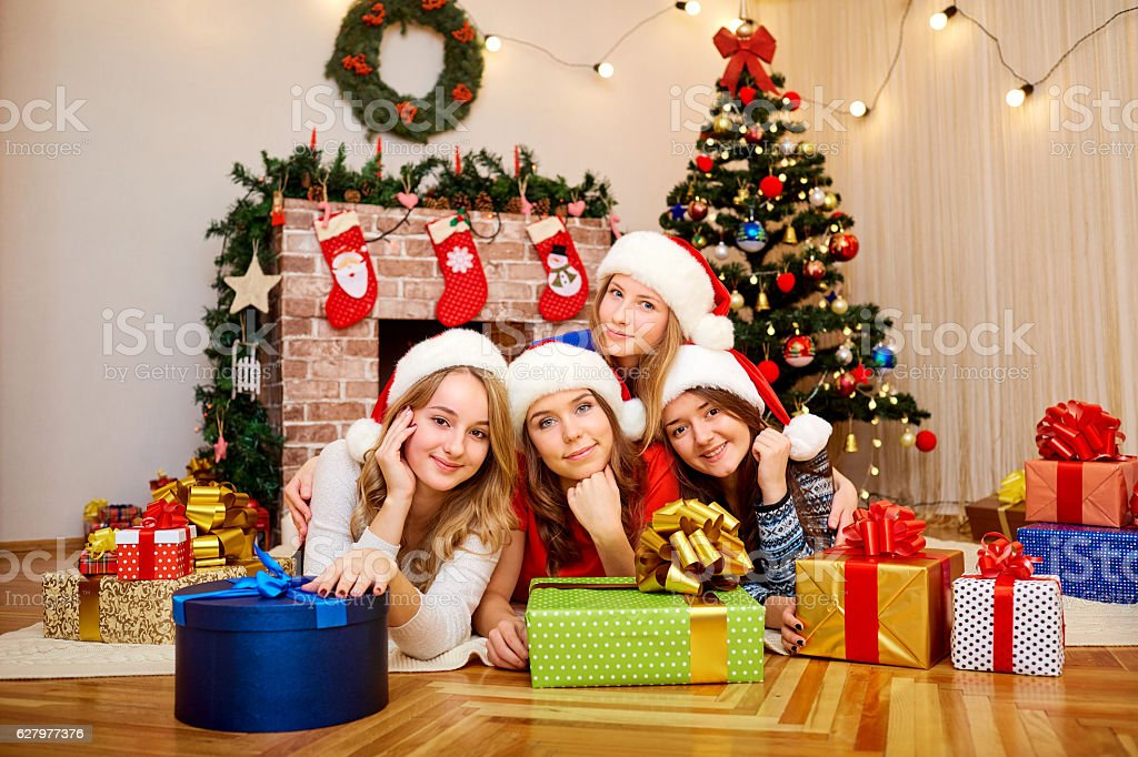 Friends at Christmas. Beautiful girl laughing and smiling with g stock photo