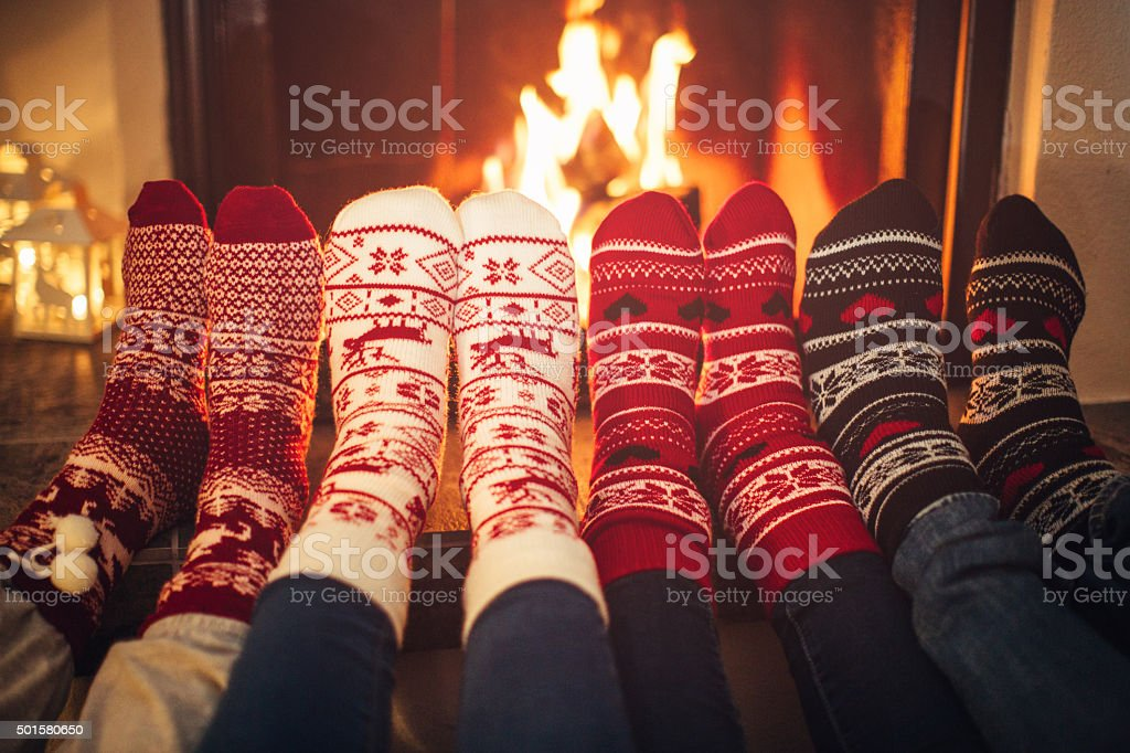 Friends at cozy winter vacation. stock photo